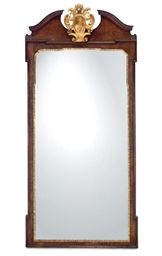A WALNUT FRAMED PIER-MIRROR
