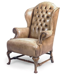 A WALNUT WING ARMCHAIR
