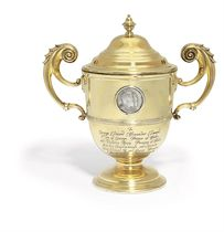 KING EDWARD VII AND QUEEN ALEXANDRA'S CHRISTENING PRESENT A VICTORIAN SILVER-GILT CUP AND COVER