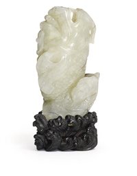 A CHINESE PALE CELADON JADE 'C