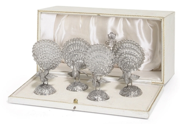 A CASED SET OF FOUR SILVER-PLA