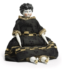 A CHINA HEADED DOLL