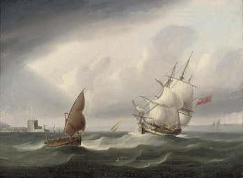 A Royal Naval frigate passing