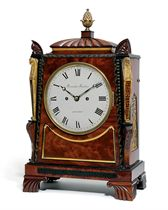 A GEORGE IV BRASS-MOUNTED MAHOGANY AND EBONISED STRIKING EIGHT DAY TABLE CLOCK IN THE EGYPTIAN REVIVAL STYLE