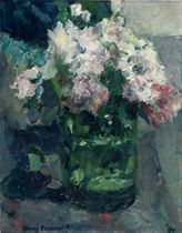 A still life with flowers in a green glass vase