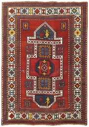 An antique Kazak large rug