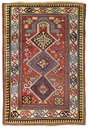 An antique Kazak prayer rug