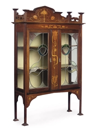 AN ART NOUVEAU MAHOGANY AND IN