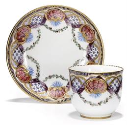 A SEVRES TEACUP AND SAUCER
