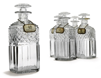 A SET OF SIX CUT-GLASS DECANTE