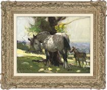 Mare and foal under a tree