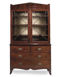 A MAHOGANY BOOKCASE ON CHEST