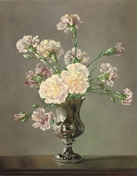 Pink carnations in a silver va