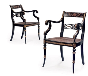 A PAIR OF EBONISED AND PARCEL
