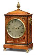 AN EARLY VICTORIAN BRASS BOUND OAK STRIKING TABLE CLOCK