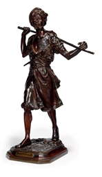 A BRONZE FIGURE OF A TRIBESMAN