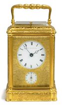 A VICTORIAN ENGRAVED GILT-BRASS STRIKING AND REPEATING CARRIAGE CLOCK WITH ALARM