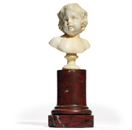 A FLEMISH IVORY BUST OF A PUTT