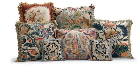 A GROUP OF SEVEN CUSHIONS