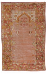 AN ANGORA USHAK PRAYER RUG