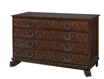AN ITALIAN WALNUT CHEST OF DRA