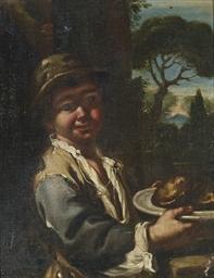 Ragazzo con dolci in un piatto