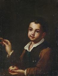 Bambino con mela e ciambella