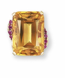 A CITRINE QUARTZ AND RUBY RING