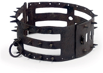 A WROUGHT-IRON DOG COLLAR