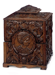 A CARVED OAK DECANTER BOX