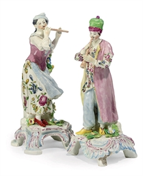 A PAIR OF BOW FIGURES OF MUSIC
