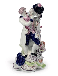 AN ENGLISH PORCELAIN FIGURE OF