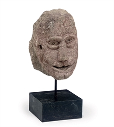 A CARVED LIMESTONE HEAD