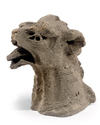 A MEDIEVAL LIMESTONE HEAD OF A