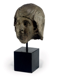 A CONTINENTAL STONE HEAD OF A
