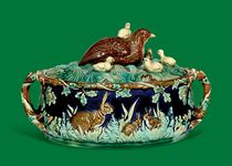 A GEROGE JONES MAJOLICA TWO-HANDLED OVAL GAME-PIE TUREEN AND COVER