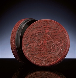 AN EXCEPTIONALLY CARVED CINNABAR LACQUER 'DRAGON' CIRCULAR B...