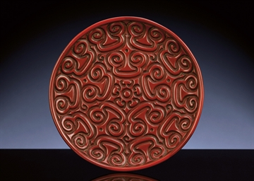 A CARVED TIXI CINNABAR LACQUER