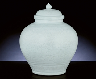 A VERY RARE CARVED WHITE-GLAZE