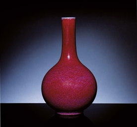 A FLAMBE GLAZED BOTTLE VASE