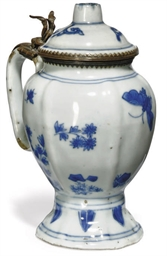 A CHINESE BLUE AND WHITE JUG