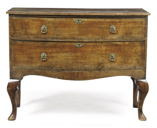 A WALNUT BOWFRONT COMMODE