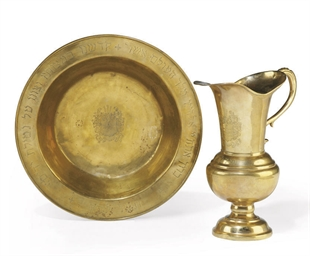 A FRENCH BRASS EWER AND BASIN