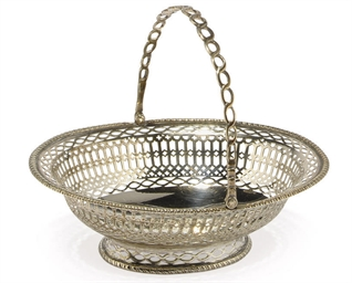 A GEORGE III OVAL SILVER SWING