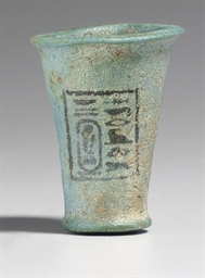 AN EGYPTIAN FAIENCE CUP FOR SE