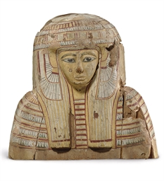 AN EGYPTIAN PAINTED WOOD MUMMY