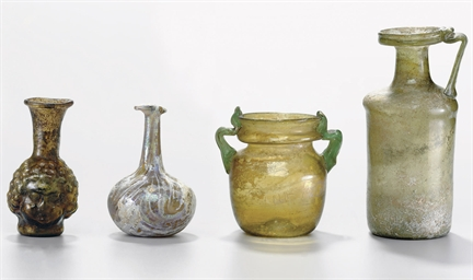 FIVE ROMAN GLASS VESSELS