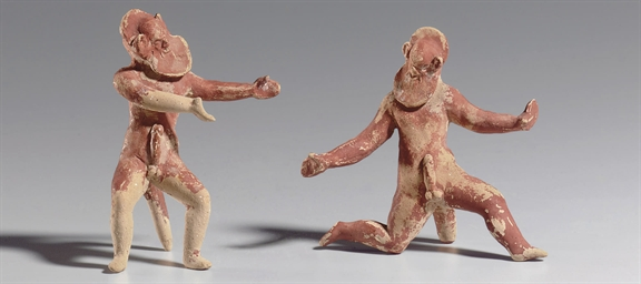 TWO GREEK TERRACOTTA SATYRS