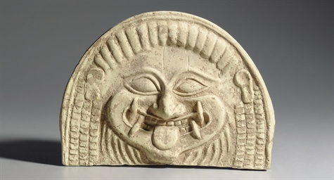A GREEK TERRACOTTA ANTEFIX