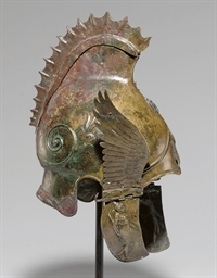 A GREEK BRONZE WINGED HELMET O